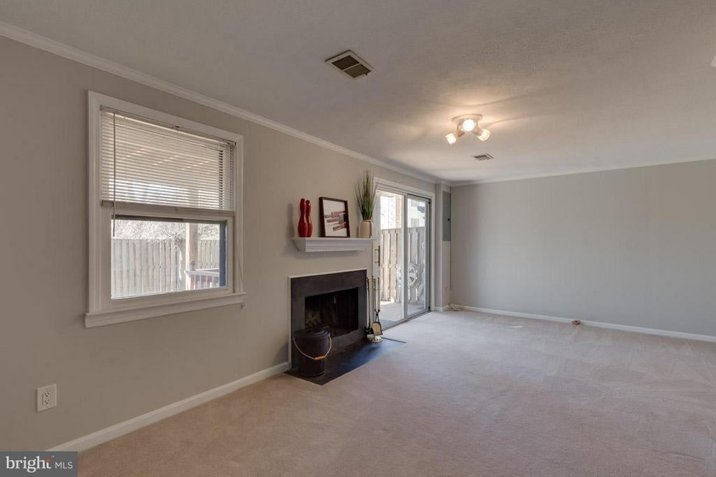 Large family room with wood burning fireplace - 9027 PINEY GROVE DR, FAIRFAX