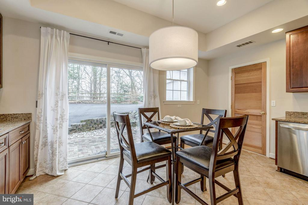 Kitchen opens to Charming Patio - 7313 PINE DR, ANNANDALE