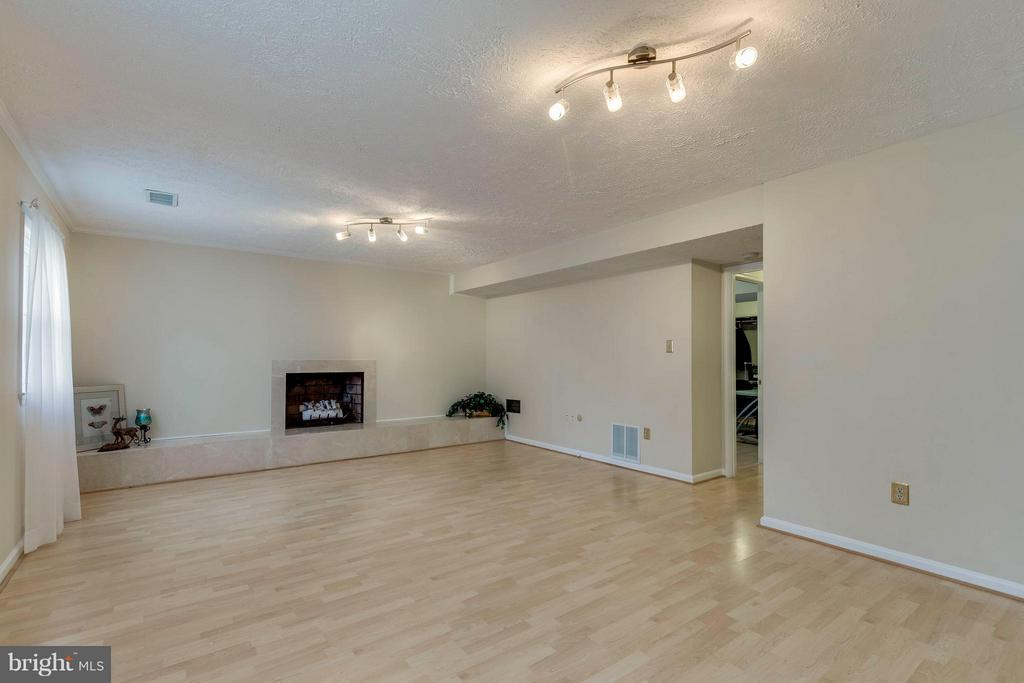 Family Room with Wood Burning Fireplace - 7411 CALICO CT, SPRINGFIELD