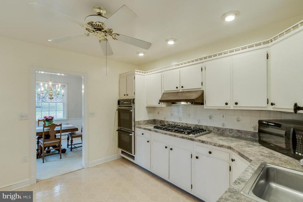 Kitchen opens to Dining Room - 6505 WAVERLEY ST, ALEXANDRIA