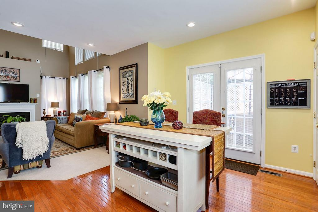 Kitchen with View into Great Room and Deck Access - 7655 HENRY KNOX DR, LORTON