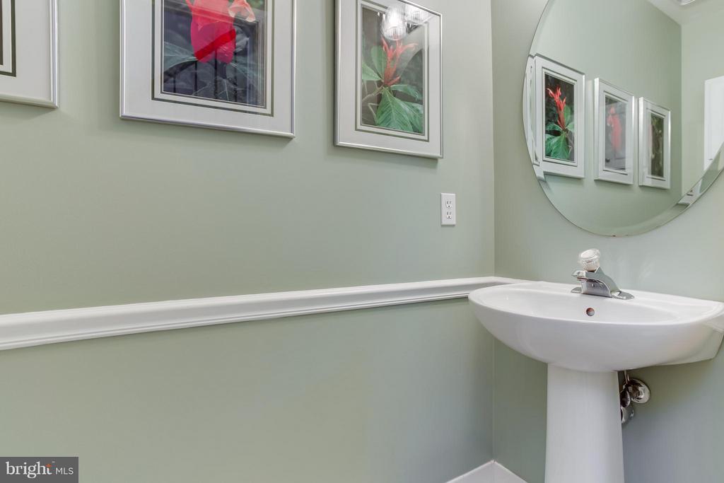 ADA-compliant toilet in the 1/2 bath - 94 NORTHAMPTON BLVD, STAFFORD