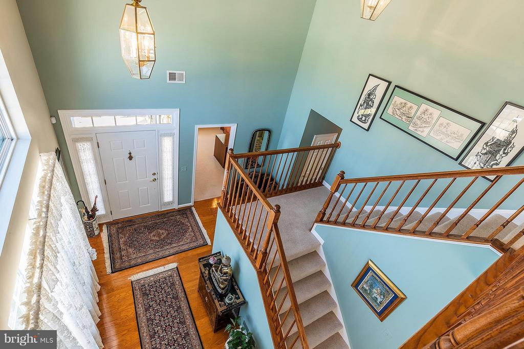 Foyer with Stairs Leading to Loft - 16016 DANCING LEAF PL, DUMFRIES