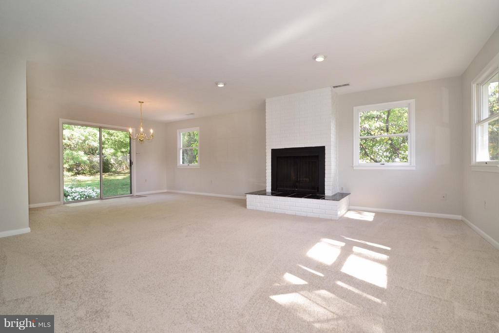 Living/dining room with wood burning fireplace - 1907 WARE RD, FALLS CHURCH