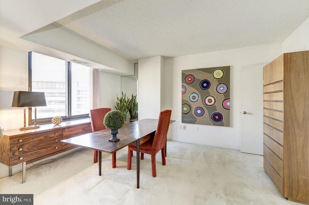 French doors provide access fro LR to  BR2/office. - 1300 CRYSTAL DR #1610S, ARLINGTON