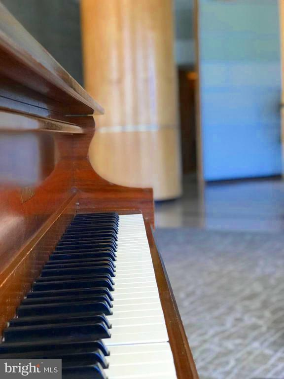 A piano in the house. - 1300 CRYSTAL DR #1610S, ARLINGTON