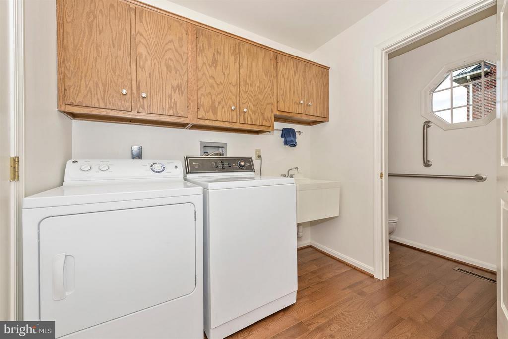 1st floor laundry with new hardwood flooring - 8210 FOX HUNT LN, FREDERICK