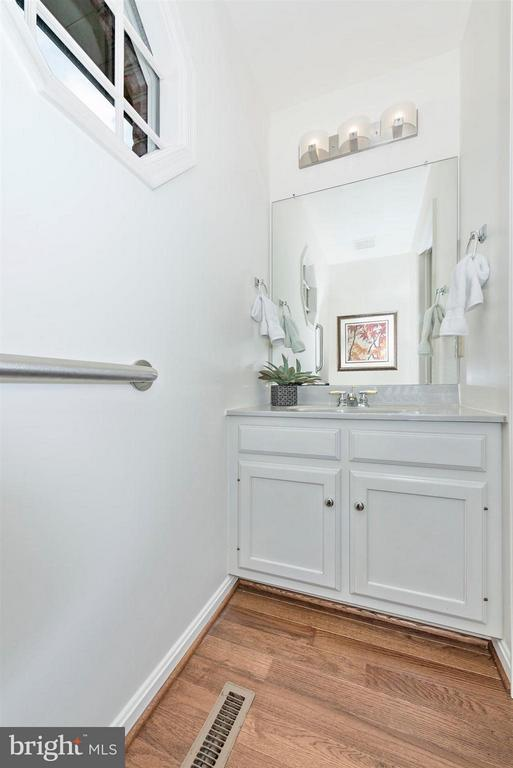 Powder Room with grab bars, new lighting and floor - 8210 FOX HUNT LN, FREDERICK