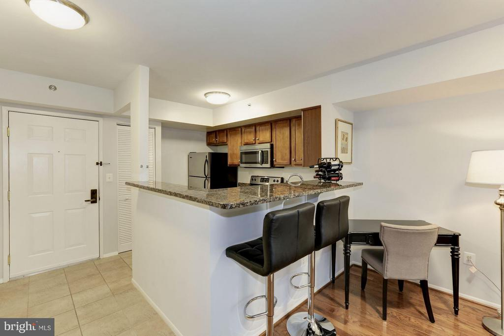 KITCHEN - OPENS BEAUTIFULLY TO LIVING ROOM! - 1001 VERMONT ST N #508, ARLINGTON