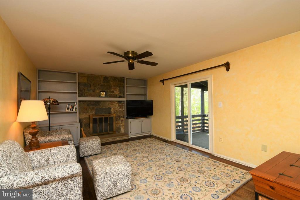 Family Room w/ Fireplace opens to Screened Porch - 12506 CHARLES STEWART CT, FAIRFAX