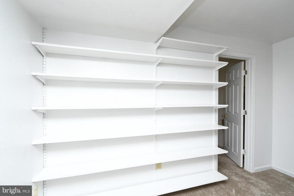 Shelving in Rec Room craft area - 12506 CHARLES STEWART CT, FAIRFAX