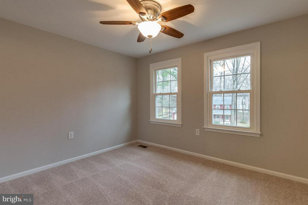 Bedroom 3 with updated ceiling fan and front views - 5912 NEW ENGLAND WOODS DR, BURKE