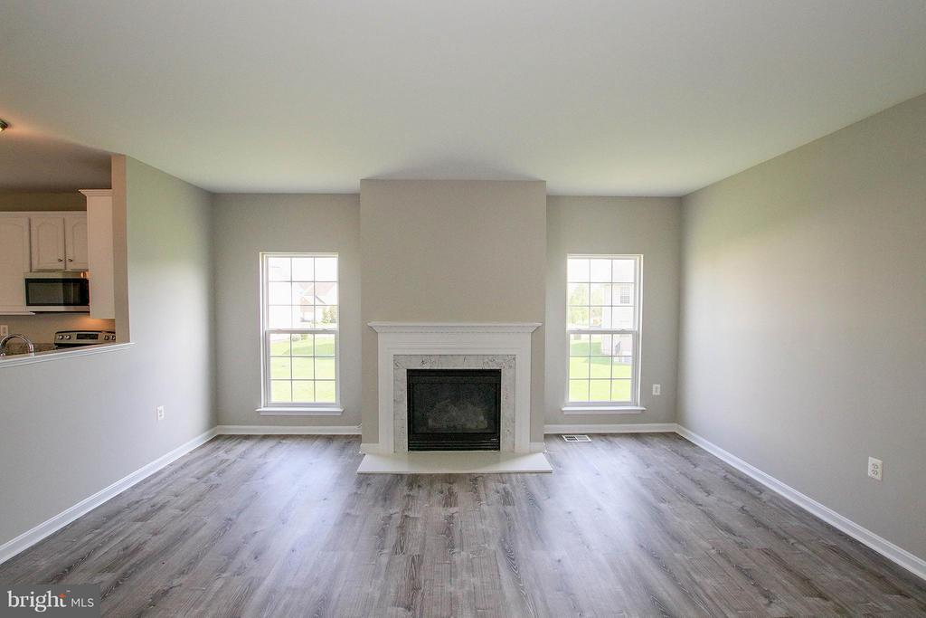 Cozy gas fireplace in the large family room - 108 CHARDIN CT, MARTINSBURG