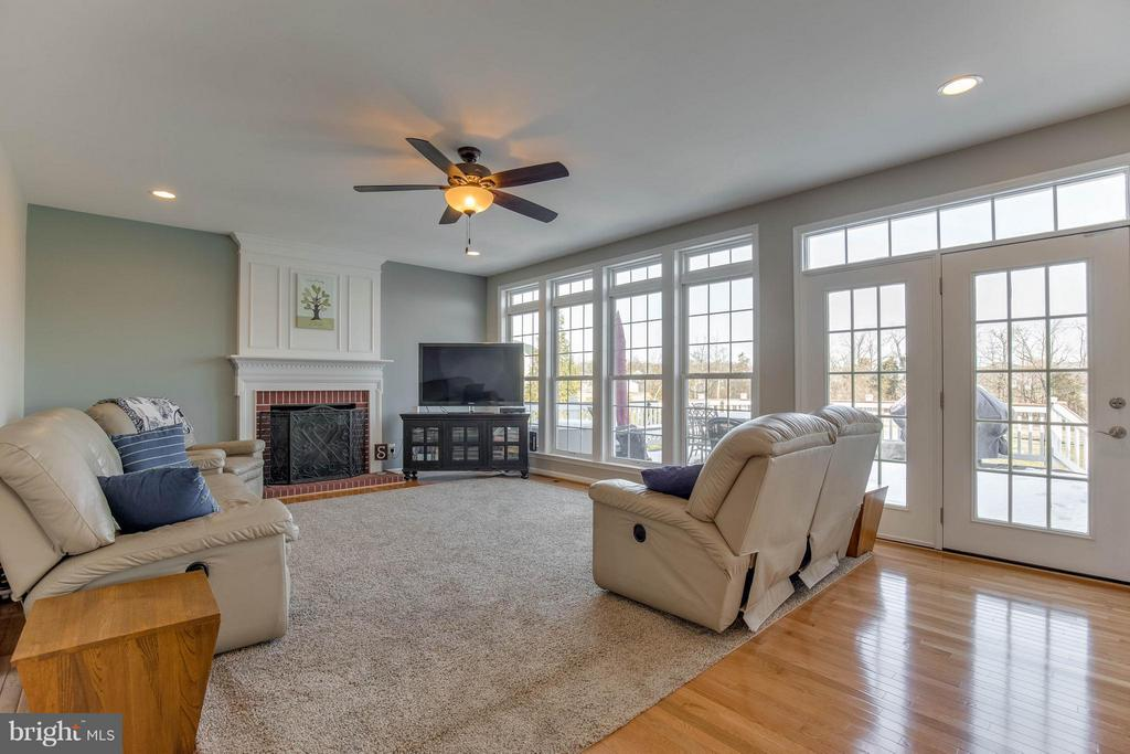 Family Room with Gas Fireplace and Hardwood Floors - 43812 CHURCHILL GLEN DR, CHANTILLY