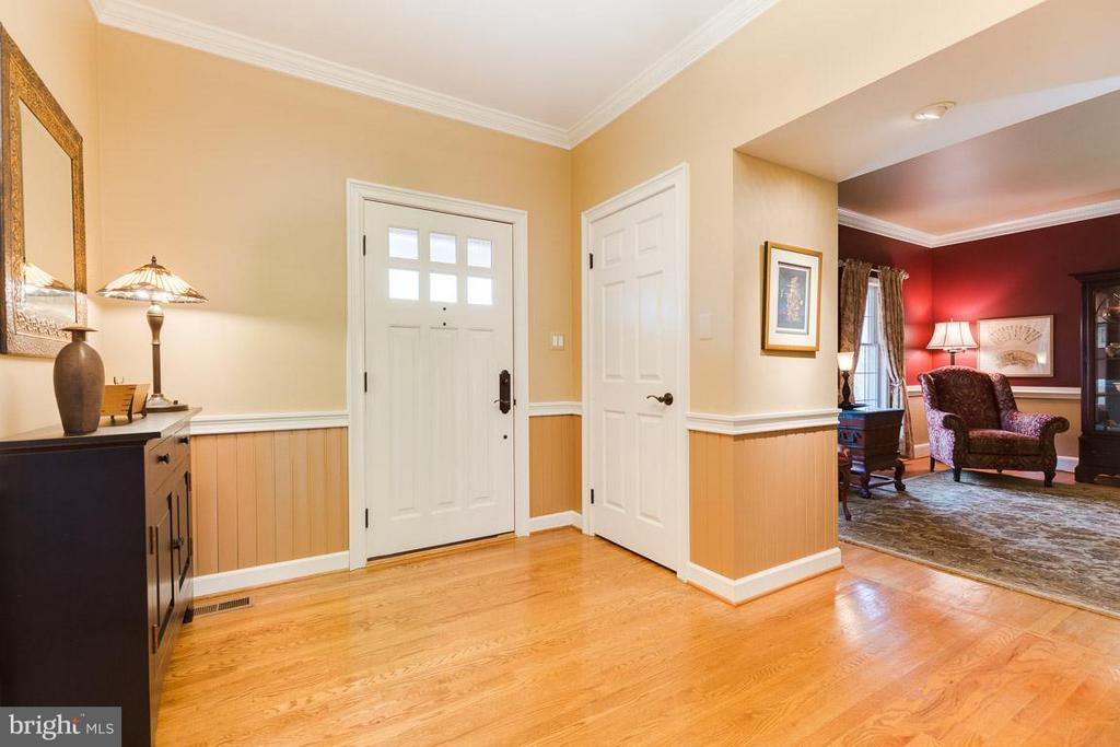 Spacious foyer with wainscoting and hardwoods. - 11079 OVERRUN DR, MANASSAS