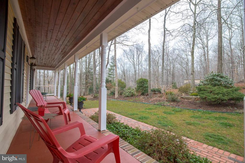 Enjoy the landscaped front yard from front porch - 11079 OVERRUN DR, MANASSAS