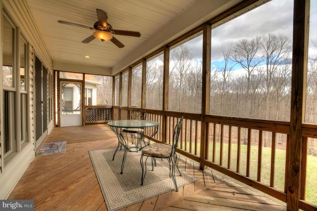 Enclosed screened porch overlooks trees - 23 CARDINAL DR, FREDERICKSBURG