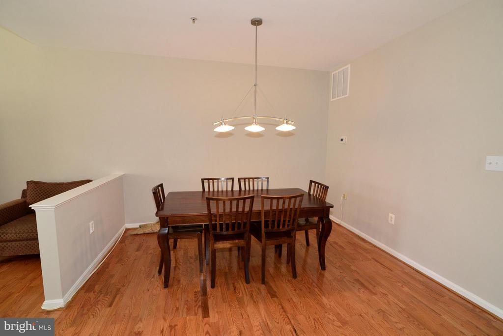 Dining room and stairs to upper level - 11406J WINDLEAF CT #9, RESTON