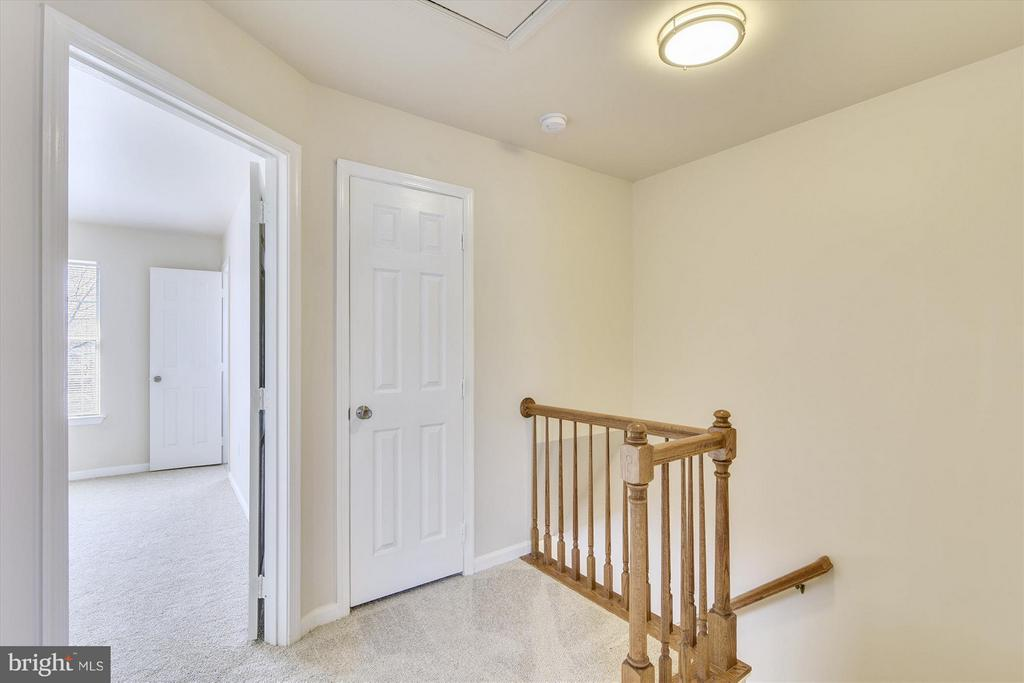 Bright Hallway Leads to Two Master Bedrooms - 508 COVINGTON TER NE, LEESBURG