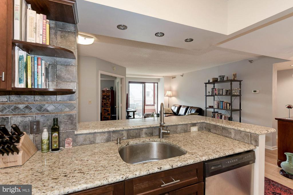 Kitchen flows into the living spae - 2400 CLARENDON BLVD #310, ARLINGTON
