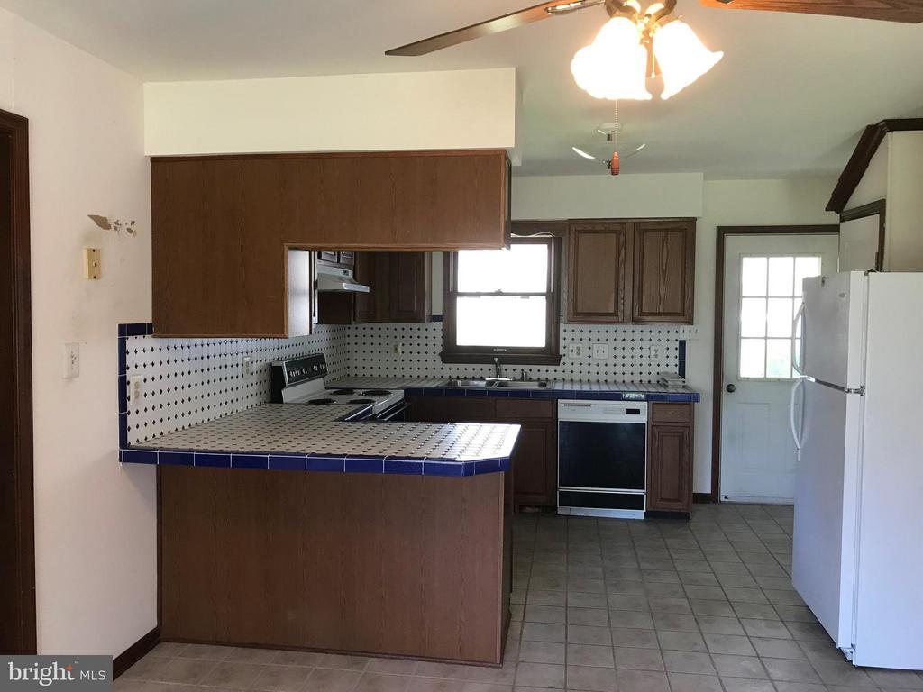 Kitchen with tile countertops - 503 WIDEWATER RD, STAFFORD