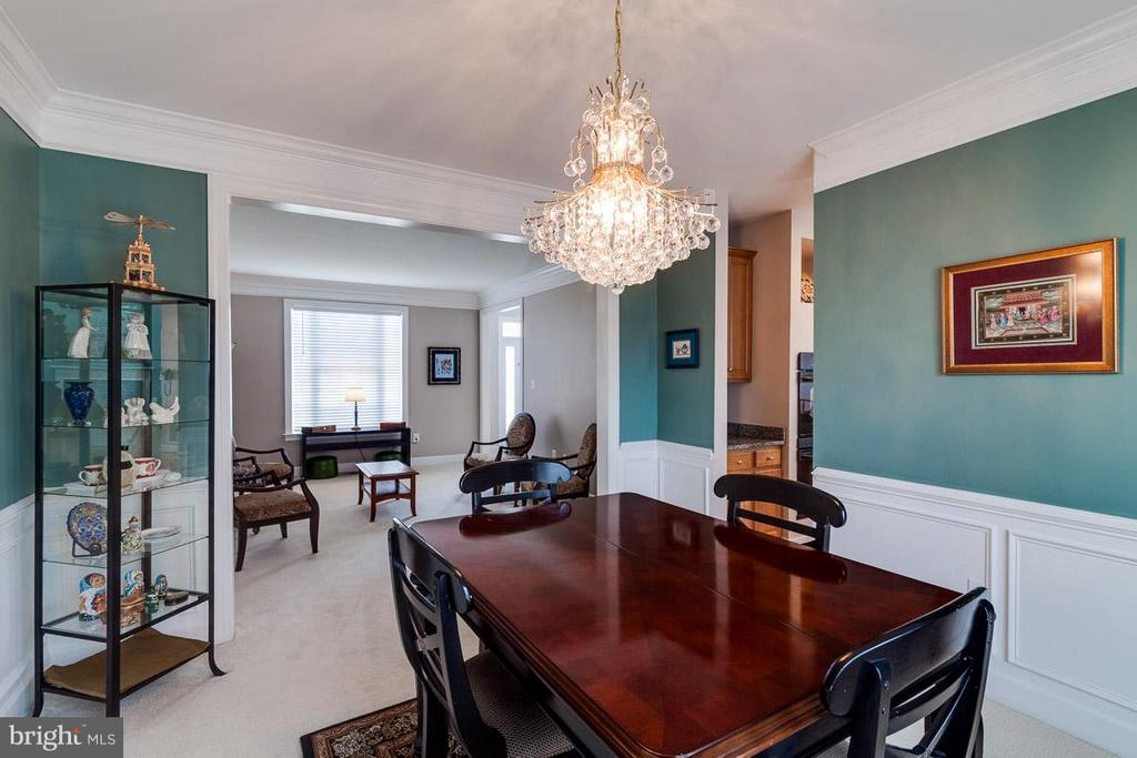 Exquisite Dining Room: Wainscoting, Chandelier - 5386 ABERNATHY CT, FAIRFAX