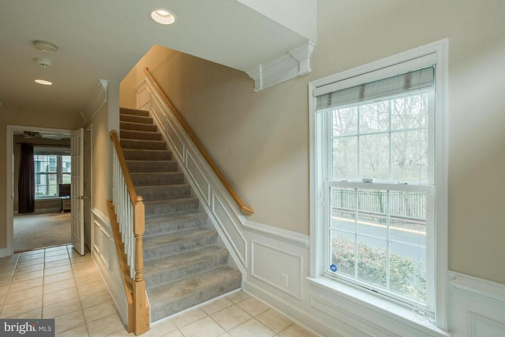 2 story foyer with wainscoting and tile floor - 2170 OBERLIN DR, WOODBRIDGE
