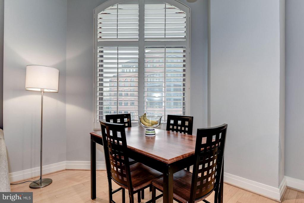 DINING ROOM - RECEIVES AN ABUNDANCE OF SUNLIGHT! - 1201 GARFIELD ST N #216, ARLINGTON