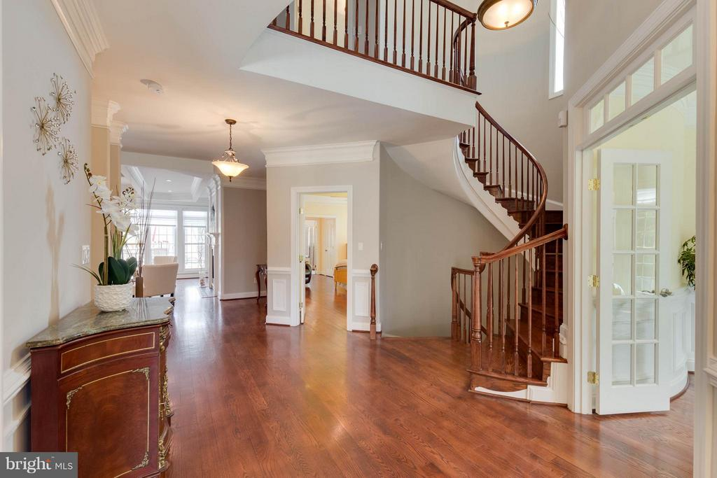 Inviting Foyer with Curved Staircase - 5521 CLIFTON RD, CLIFTON