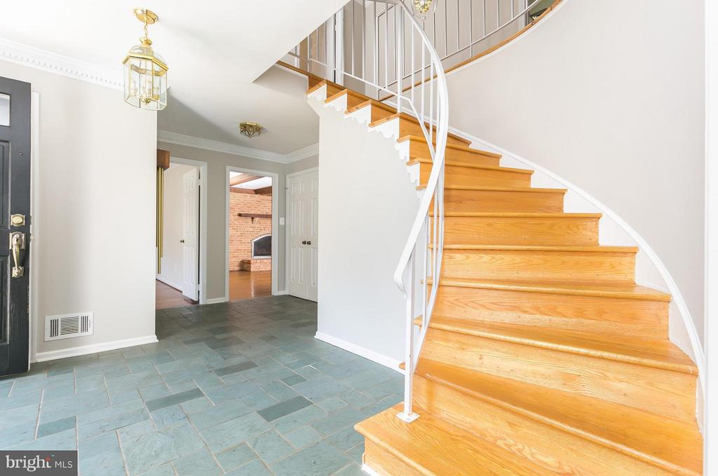 Foyer w/ Slate Floor & HW Circular Staircase - 8029 OLD DOMINION DR, MCLEAN