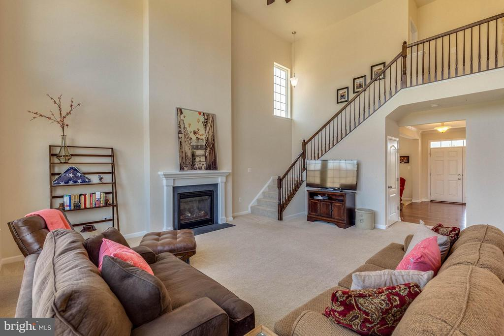 Family Room boasting Grand staircase - 1018 HUNTERS KNL, MYERSVILLE
