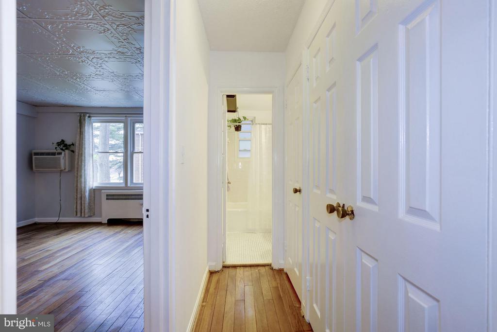 Closets line the hallway space - 110 GEORGE MASON DR #110-1, ARLINGTON