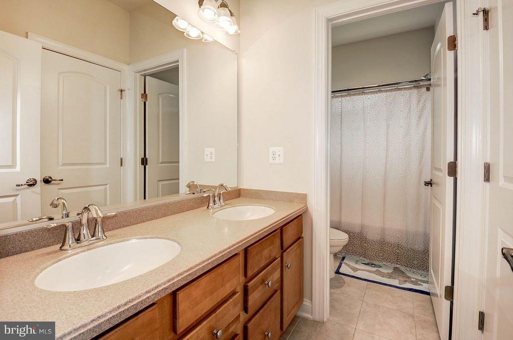 Double vanity in the upstairs bathroom - 42709 ASHBURN TILLETT DR, BROADLANDS