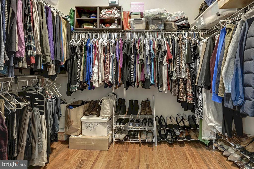 His and hers walk-in closets in the master bedroom - 42709 ASHBURN TILLETT DR, BROADLANDS