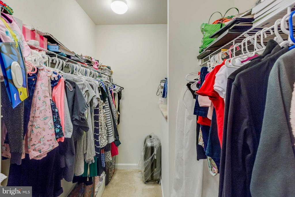 1 of 2 Walk in closets in MBR/storage over stairs - 5210 STREAM BANK LN #301G, GREENBELT