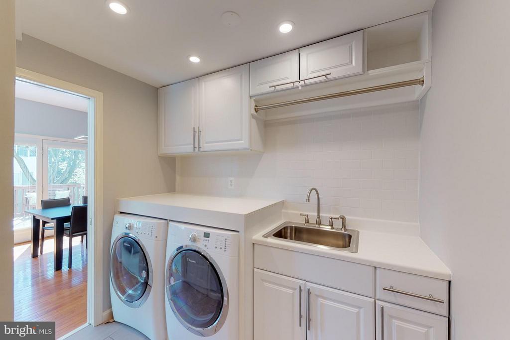 Main Level Laundry with Pocket Doors - 1311 GATESMEADOW WAY, RESTON