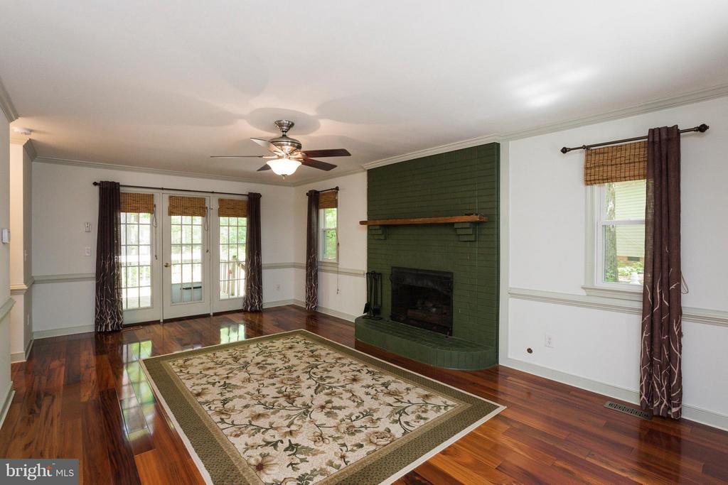 Living Room gas fireplace,opens to deck - 103 FLINTLOCK CT, LOCUST GROVE