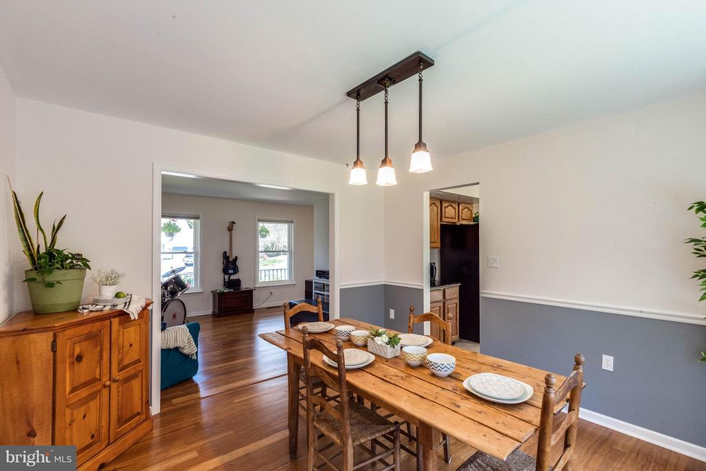 Dining room and living room view. - 10257 MEADOW FENCE CT, MYERSVILLE