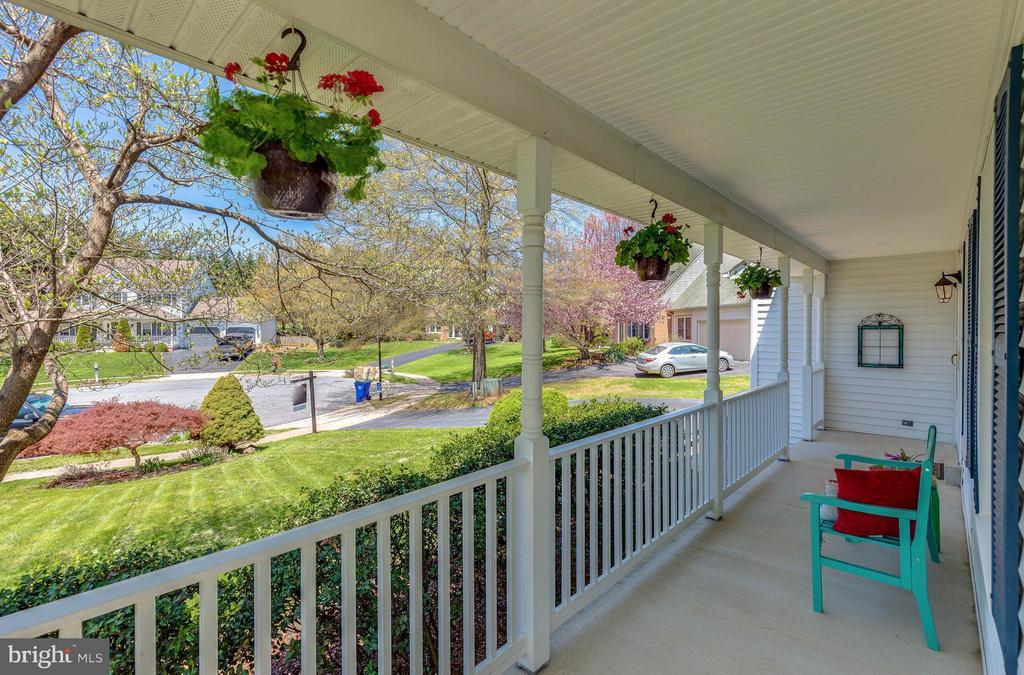 Peaceful porch that wraps around the entire home. - 10257 MEADOW FENCE CT, MYERSVILLE