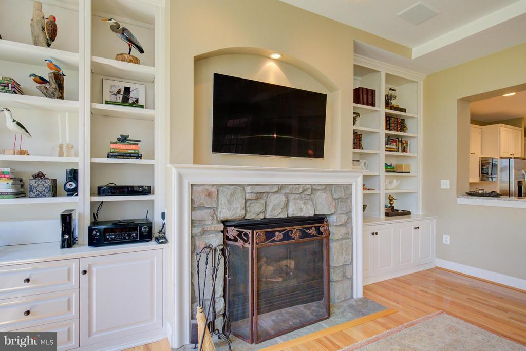 Family Room with Stone Fireplace - 43531 FIRESTONE PL, LEESBURG