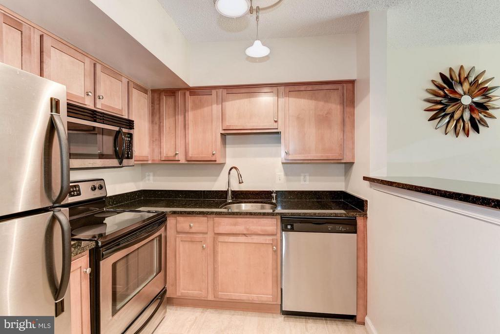 KITCHEN - SPACIOUS, LOADS OF CABINETRY STORAGE! - 1001 RANDOLPH ST N #320, ARLINGTON