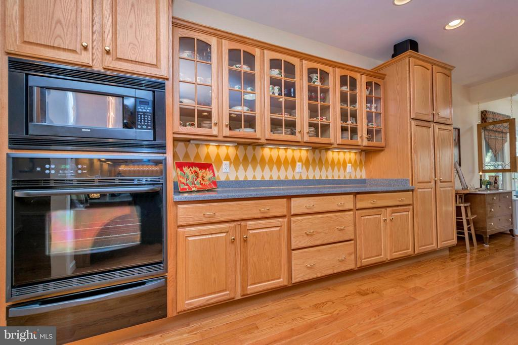 Glass front cabinets ,wall oven and microwave - 1101 EASTOVER PKWY, LOCUST GROVE