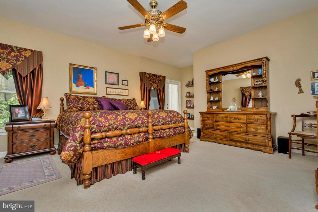 Large master bedroom walks out to open deck - 1101 EASTOVER PKWY, LOCUST GROVE