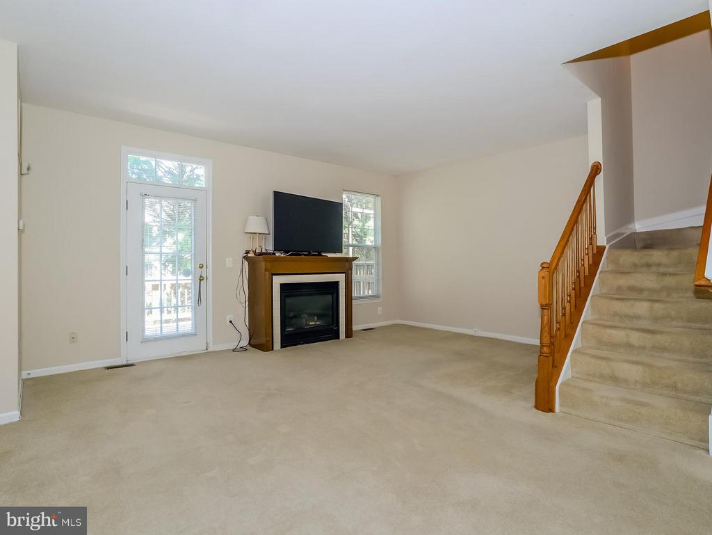 Living Room with FP and Deck Access - 11438 ABNER AVE, FAIRFAX