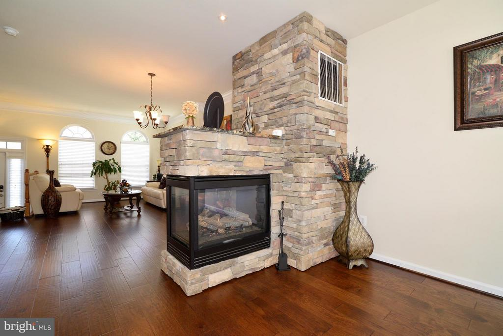 3-sided Fireplace with custom flagstone hearth - 4661 CARISBROOKE LN, FAIRFAX