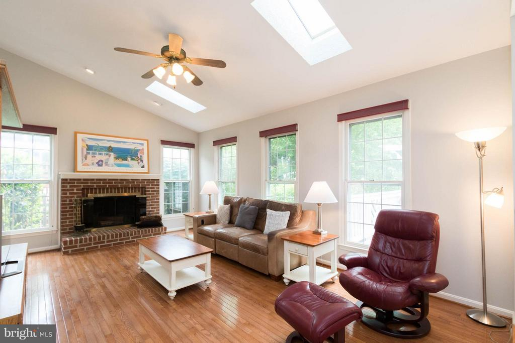 Family Room w/ wood burning fireplace - 117 ELKRIDGE WAY NE, LEESBURG