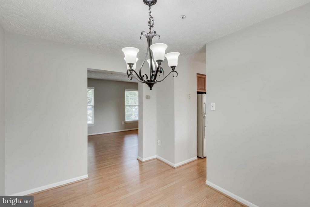 Dining Room to LR with door to right to Kitchen - 5 WISELY SQUARE CT, GAITHERSBURG