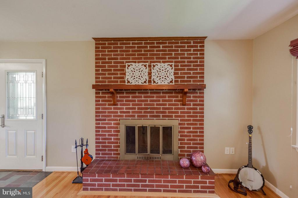 Brick-front, wood burning fireplace is timeless - 5719 MOUNT PHILLIP RD, FREDERICK