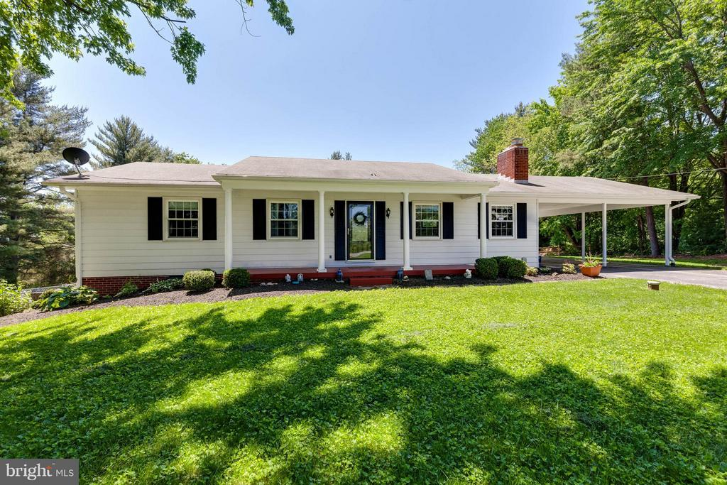 Mature landscaping lends shade to your front yard - 5719 MOUNT PHILLIP RD, FREDERICK