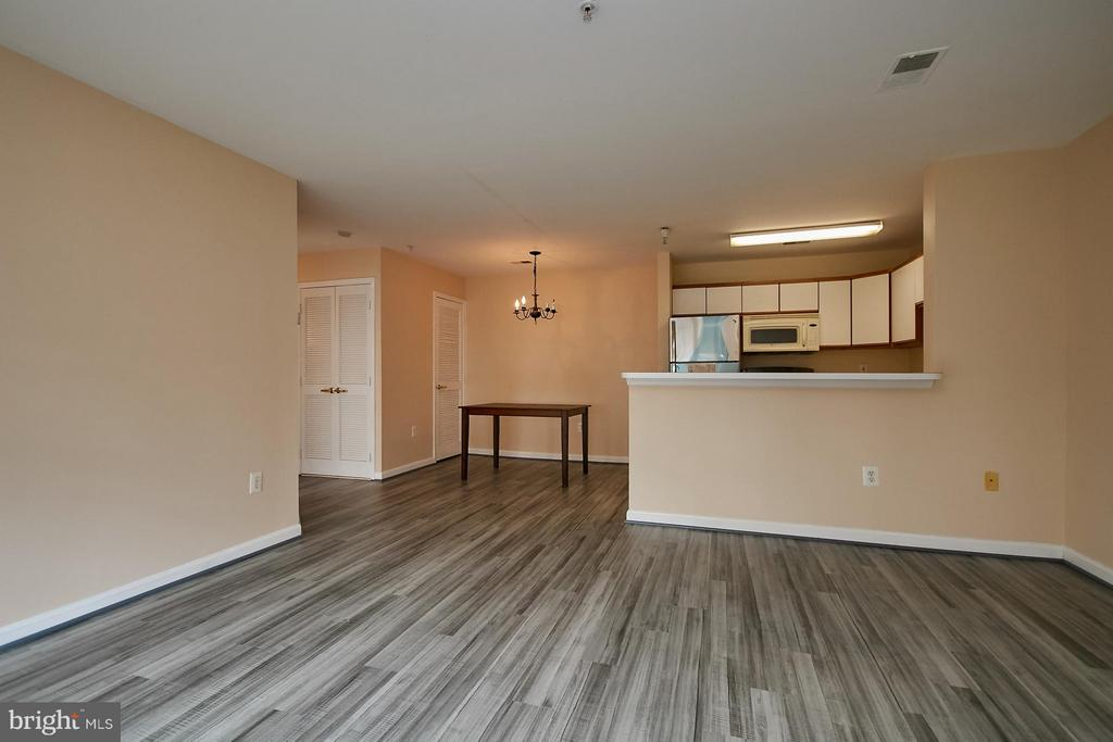 Dining Room view from the Living Room - 645 CONSTELLATION SQ SE #A, LEESBURG